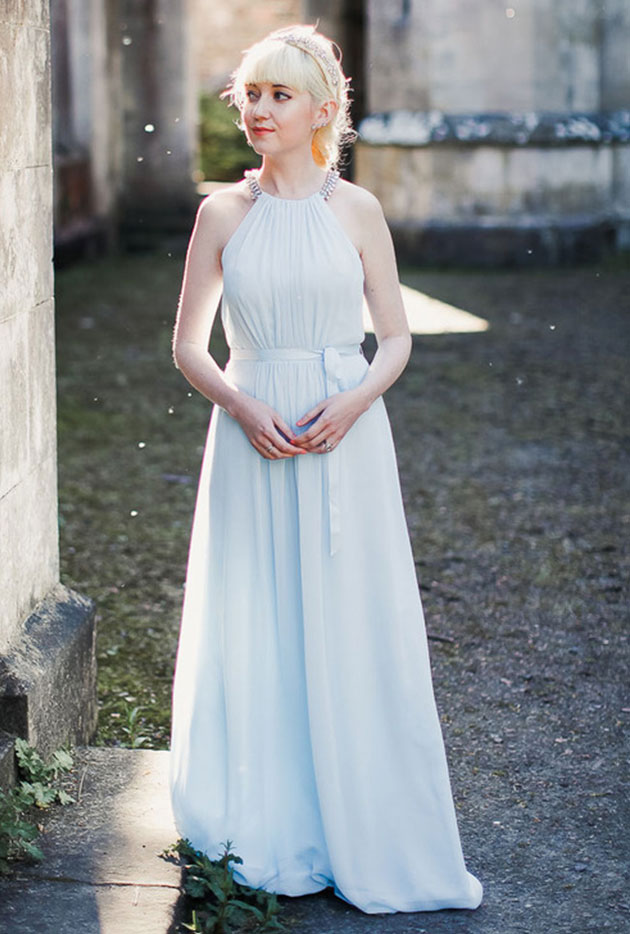 Rebecca backlit by sunshine while wearing Jenny Packham formal gown