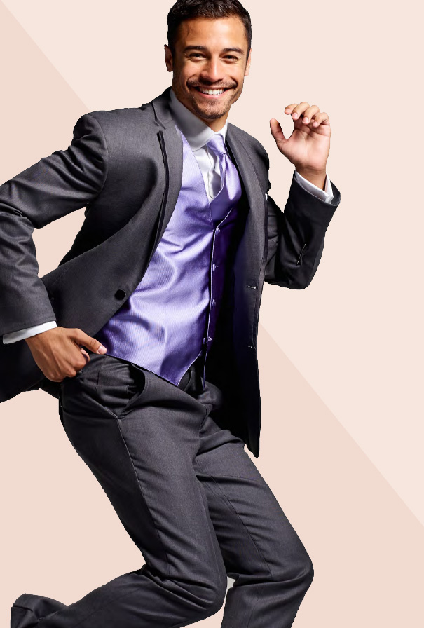 Groom posing in tuxedo with pastel vest 1b4d31248e58