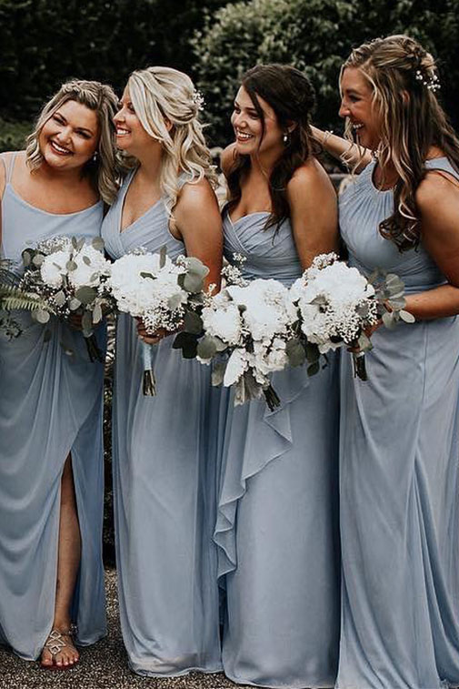 b7b5409dee7 Four bridesmaids in pale blue dresses posing closely holding white floral  bouquets