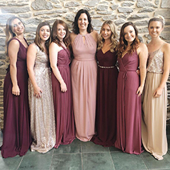 Multicolor bridal party wearing shades of pink and purple