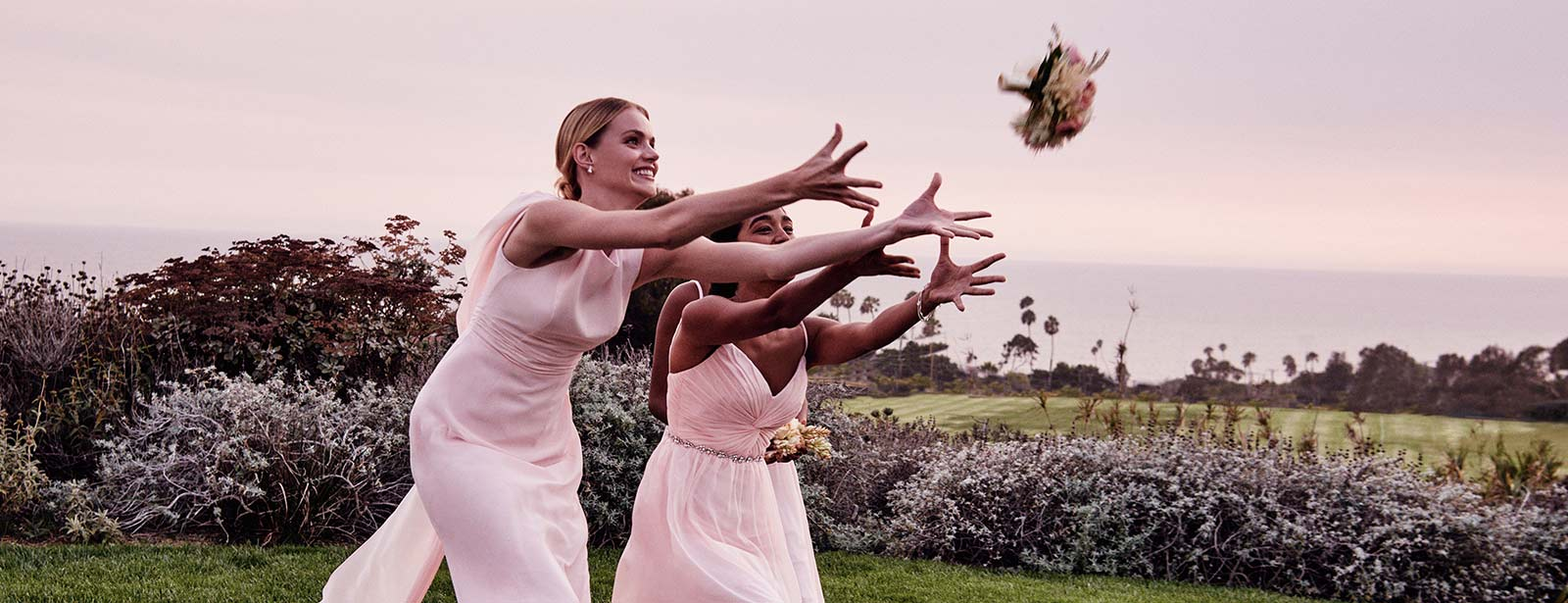 Mismatched Bridal Party Reaches for Tossed Bouquet