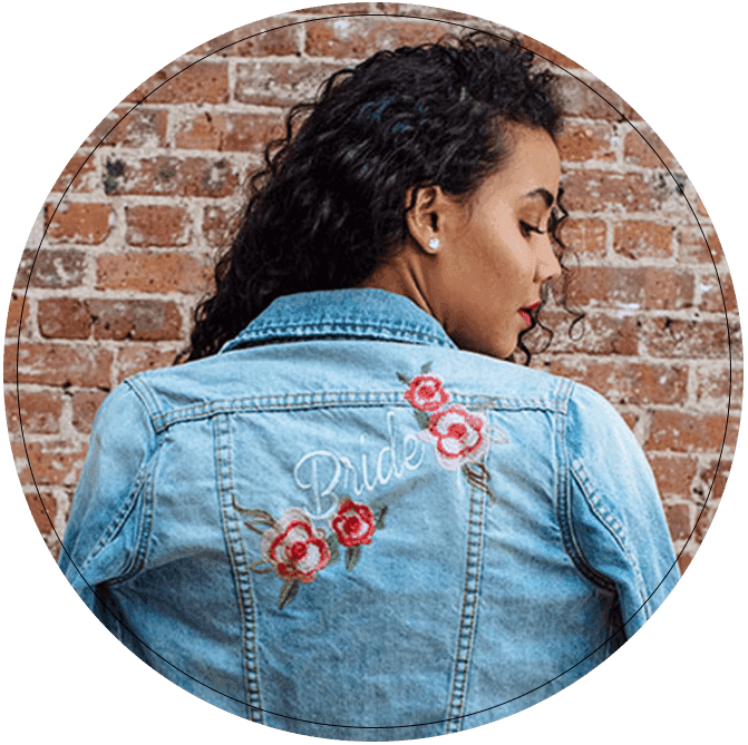 Back of jean jacket embroidered with Bride and floral details