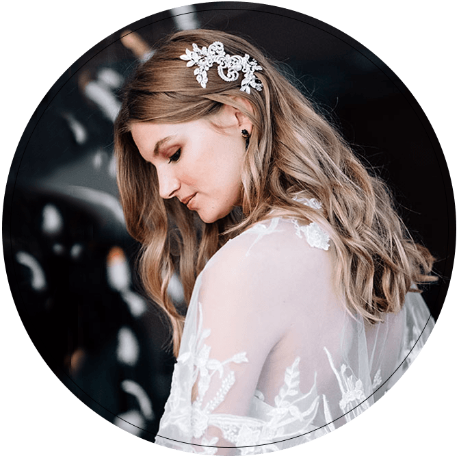 Bride with long flowing hair and embellished hair accessory