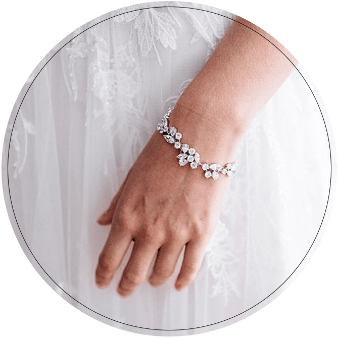 Close up of bride wearing rhinestone floral design bracelet