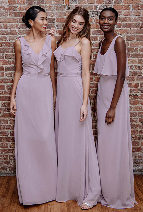 Three bridesmaids wearing  Spring 2019 bridesmaid dresses with soft ruffles.