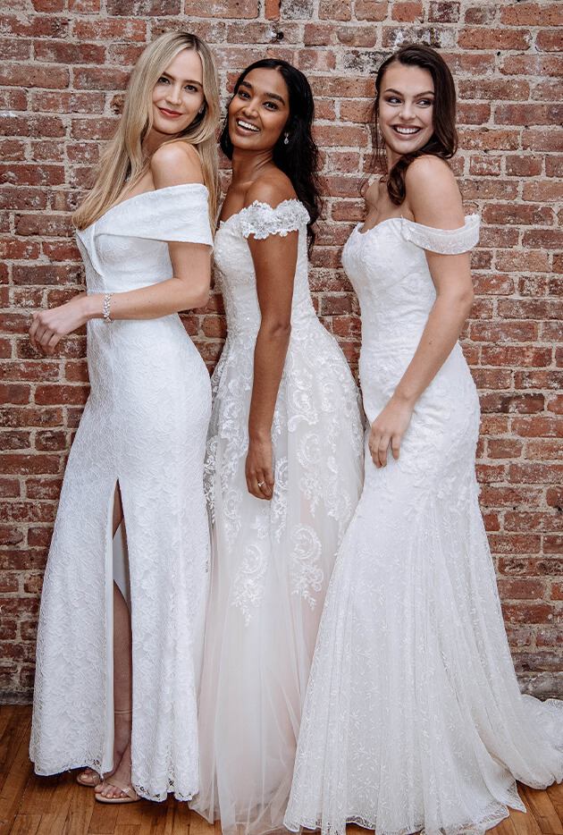 Three brides wearing off-the-shoulder Spring 2019 wedding dresses.