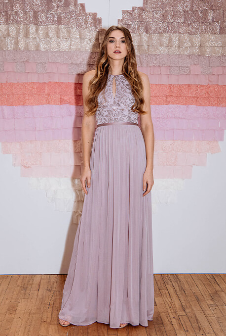 Bridesmaid wearing high neckline and subtle shine bridesmaid dress.