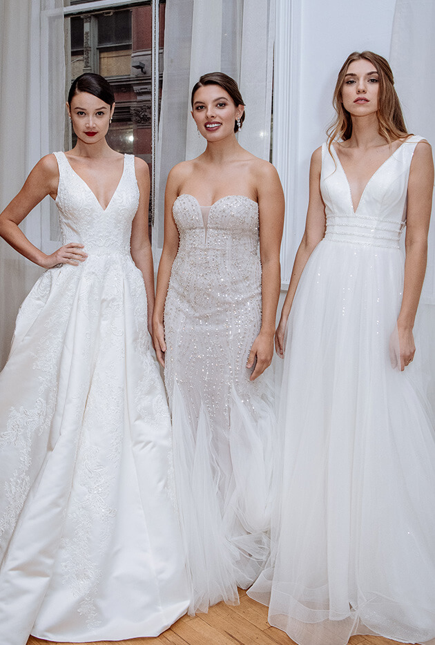 Three brides wearing Spring 2019 wedding dresses with trends of sparkle.