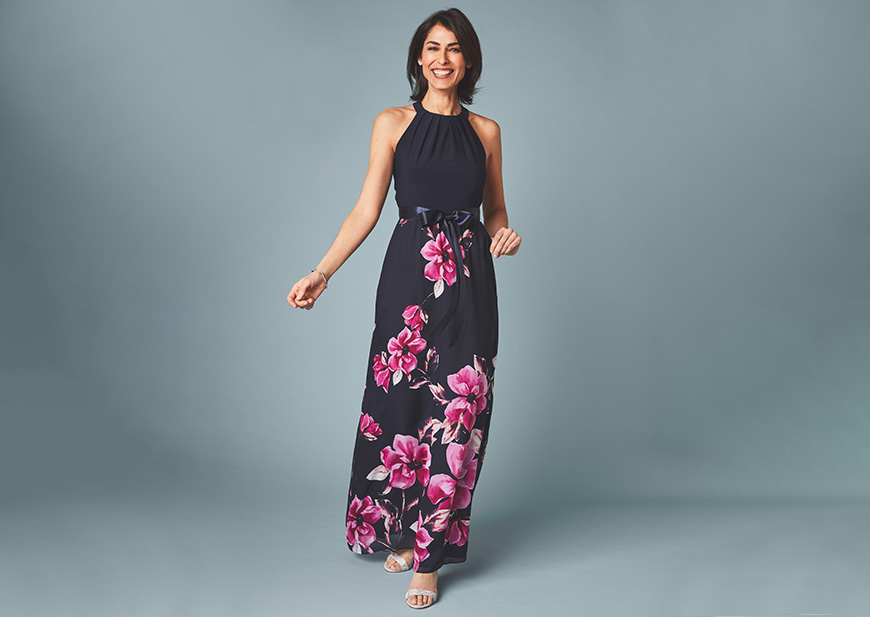 Woman in floral-print high-neck gown