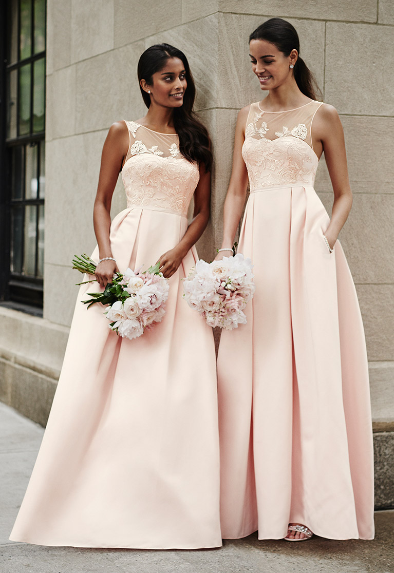 Oleg cassini davids bridal bridesmaids leaning against nyc building in pink dresses ombrellifo Choice Image