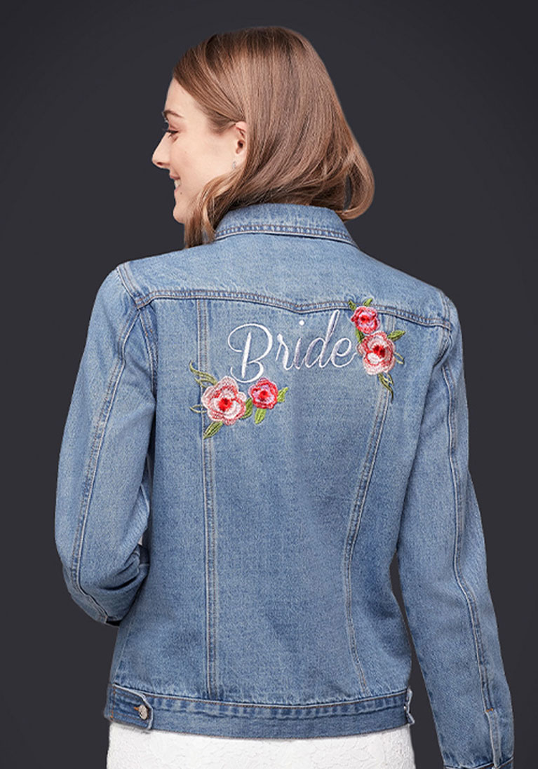 Bride wearing personalized jean jacket with wedding dress.