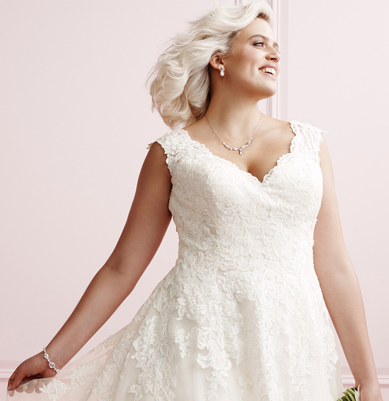 605af44f3e73 Bride wearing one shoulder plus size wedding dress with another bride in  background ...