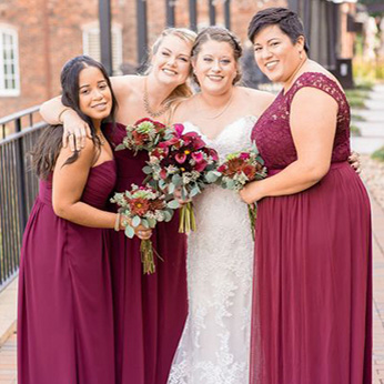 Real bride with bridesmaids wearing long wine dresses