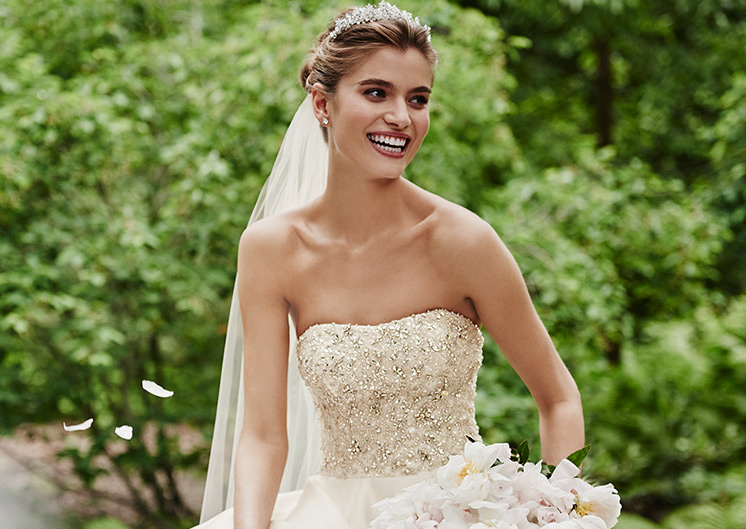 Bride wearing beaded bodice ball gown with sparkling tiara