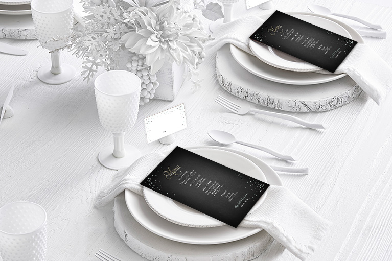 Black menu card on white dinnerware