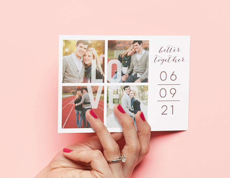 Bride's hand holding a wedding invitation