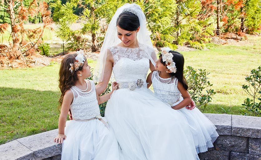 Bride sitting with two flower girls