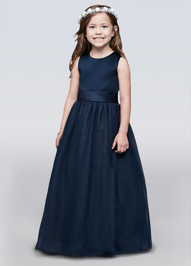 Flower girl smiling in dark blue dress with white flower crown