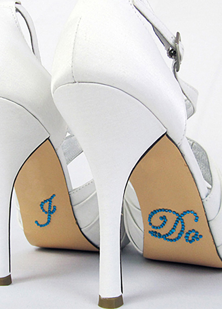 d5eda5cfa White high heels with blue I Do stickers underneath