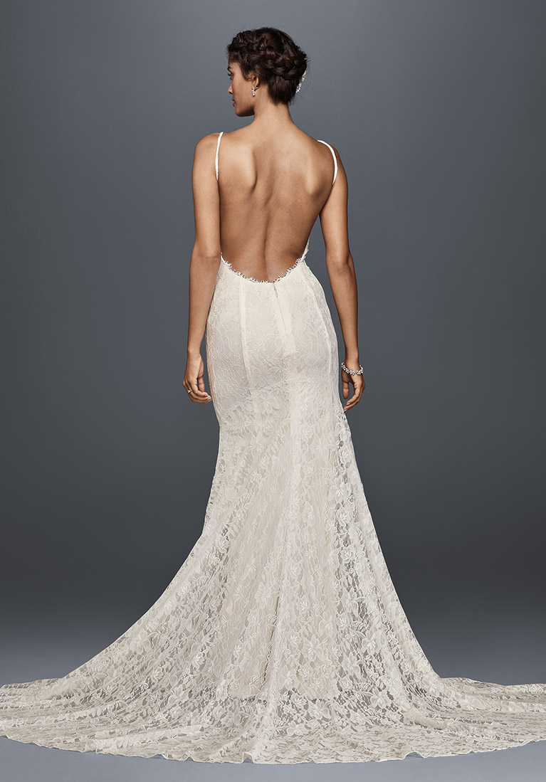bride wearing low-back long wedding dress