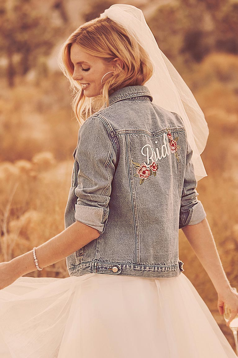 bride in denim jacket