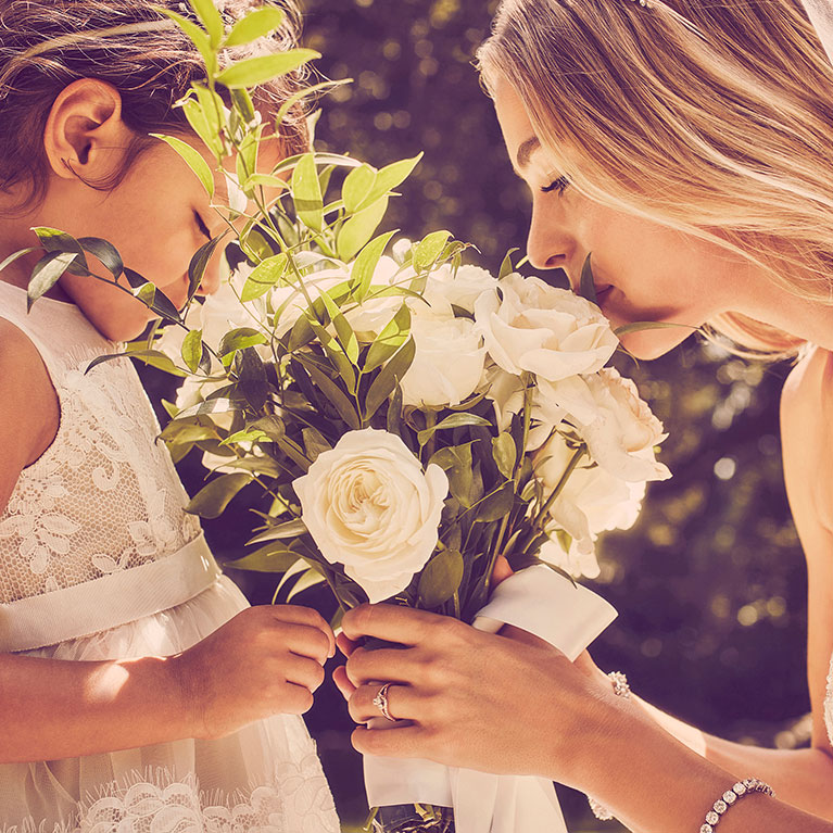 flower girl and bride with white roses