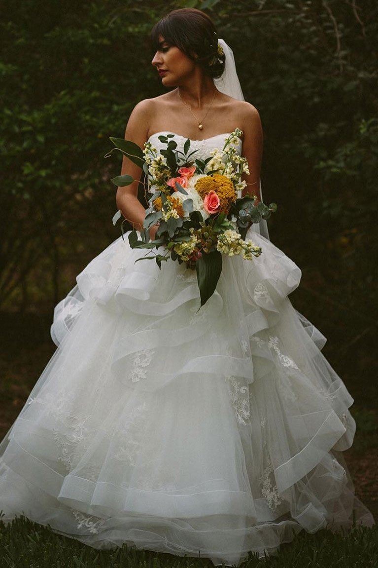 bride in ballgown dress with bouquet