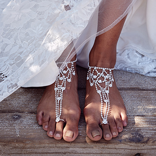 Picture of a bride's feet in foot jewelry for a Beach Wedding