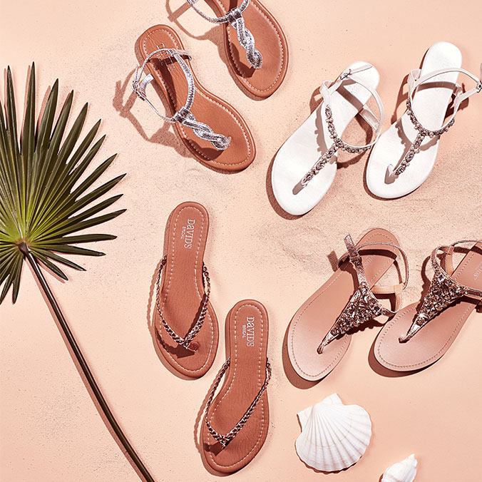 Four pairs of fancy sandals for weddings.
