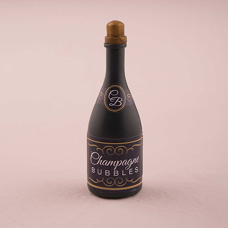 Image of champagne on a pink background