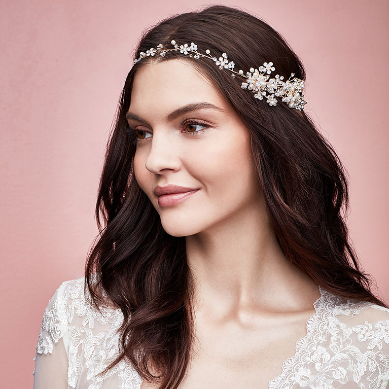 Head shot of a bride with a crystal flower crown