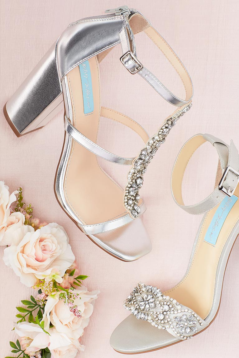 Silver and crystal strapped heels next to flower crown