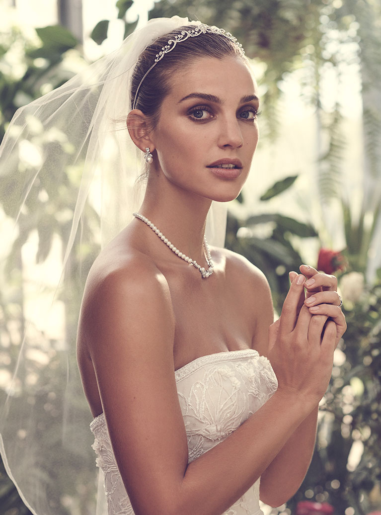 Alt Image - Bride wearing strapless wedding dress with jeweled tiara and veil.