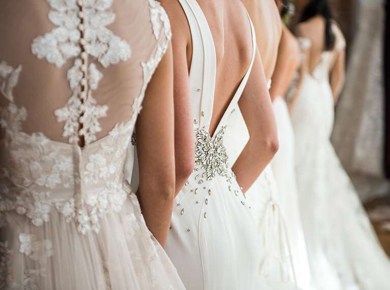 Back view of various wedding dresses