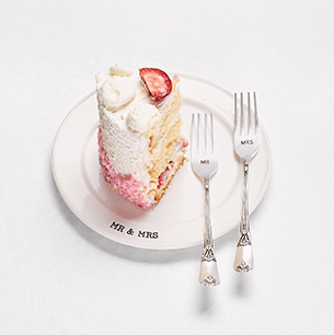 Image of cake on Mr & Mrs Cake Dish with forks.