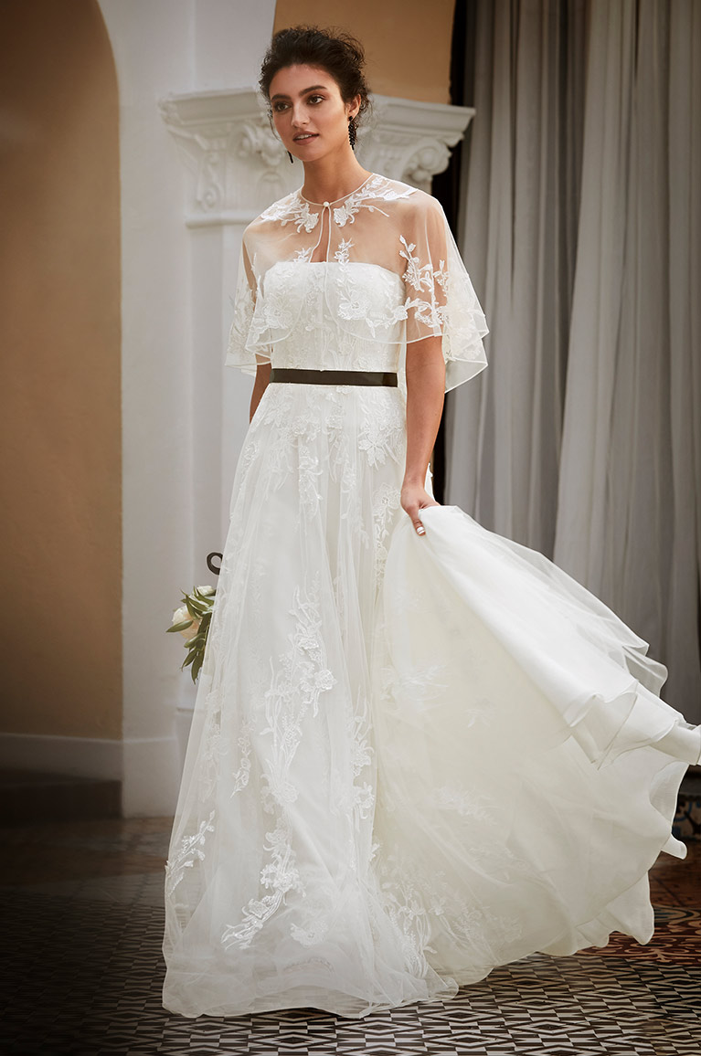 Topper on strapless bridal gown.