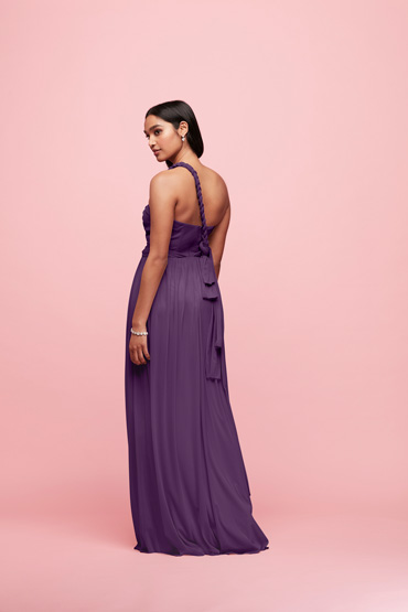Side view of Plum long convertible bridesmaid dress tied in braided one shoulder style