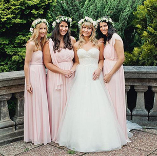 Three Bridesmaids in Jersey Versa Petal Hugging the Bride