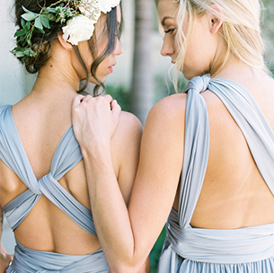 Two Bridesmaids in Jersey Ice Blue Display Different Versa Stylings