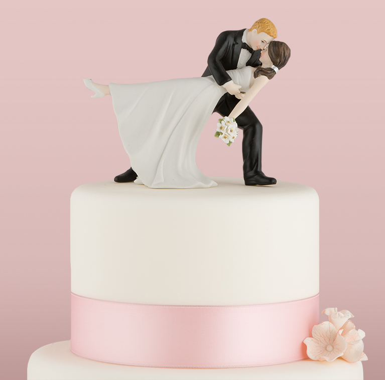 couple kissing cake topper