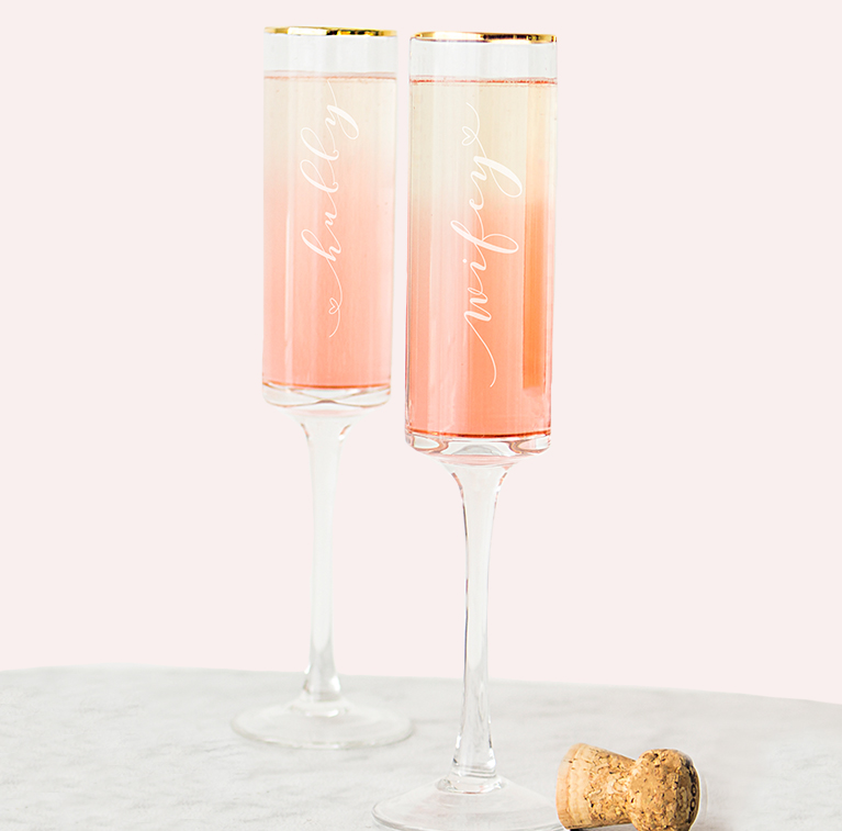 champagne glasses that say 'hubby' and 'wifey'
