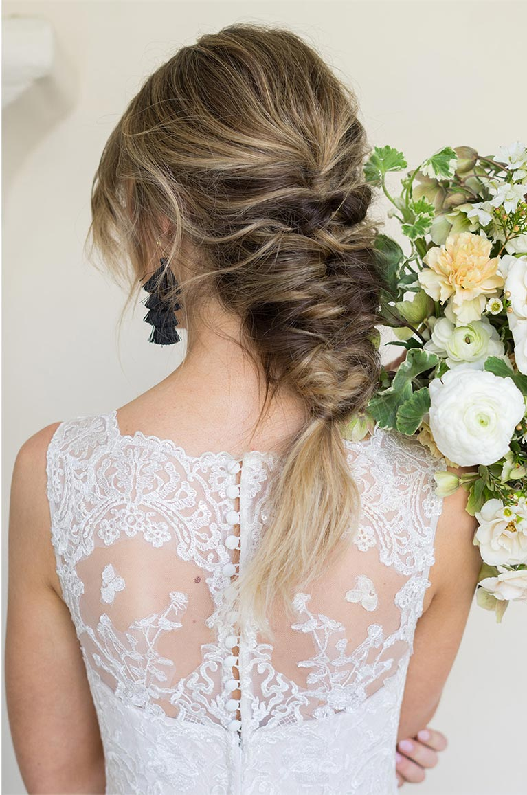 Bride wearing a braided updo hairstyle