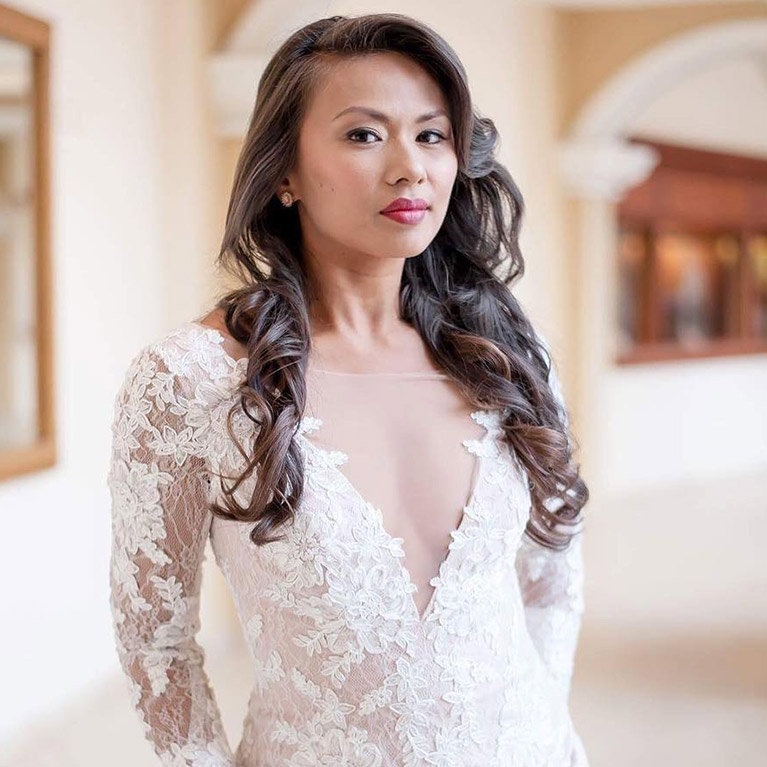 Bride with long curls and plunging neckline wedding gown