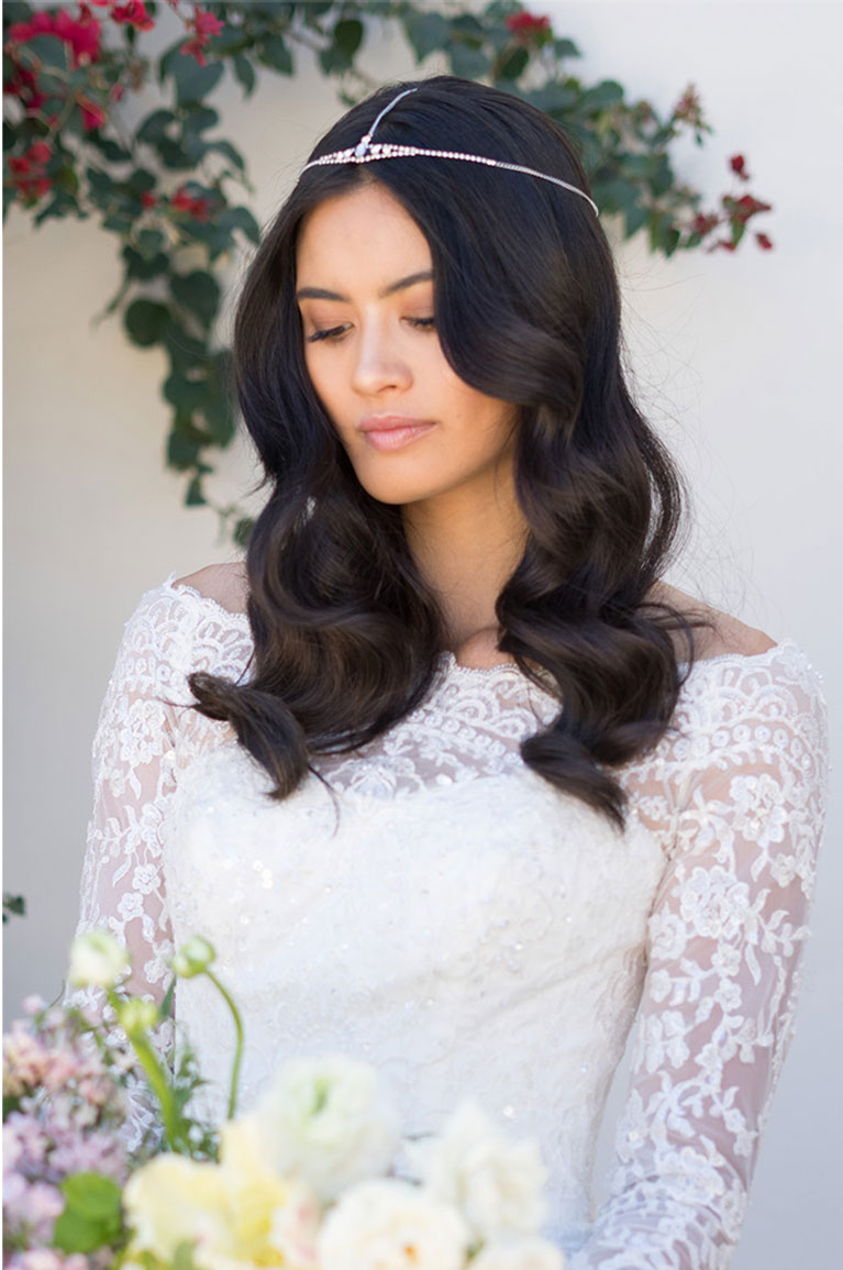 Bride wearing headband with soft wavy hairstyle