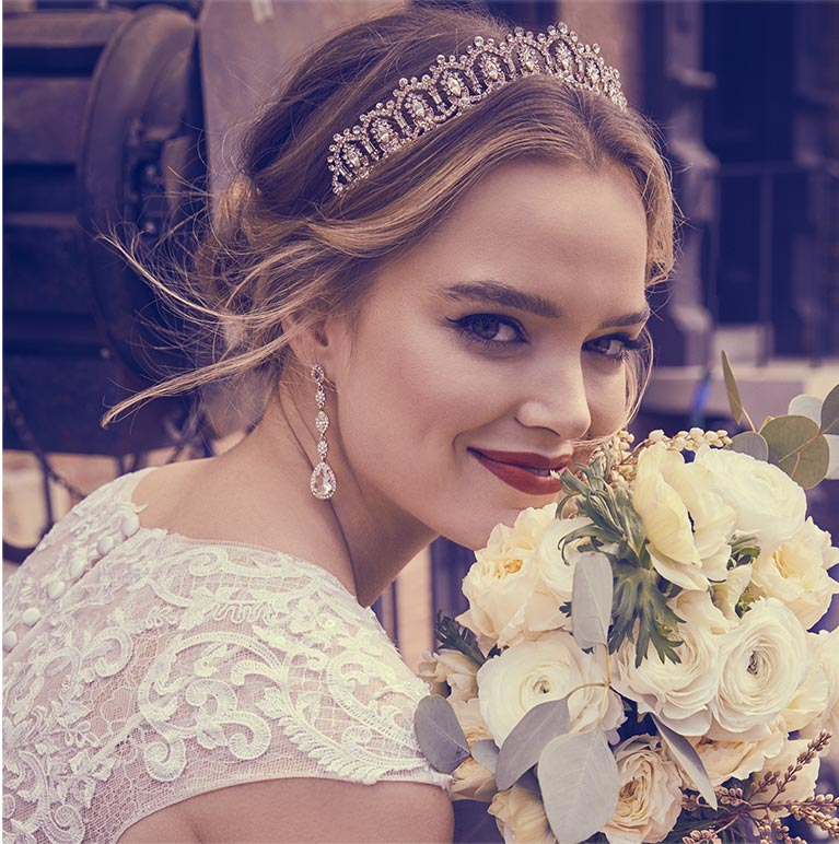 bride wearing pulled back hairstyle with tiara