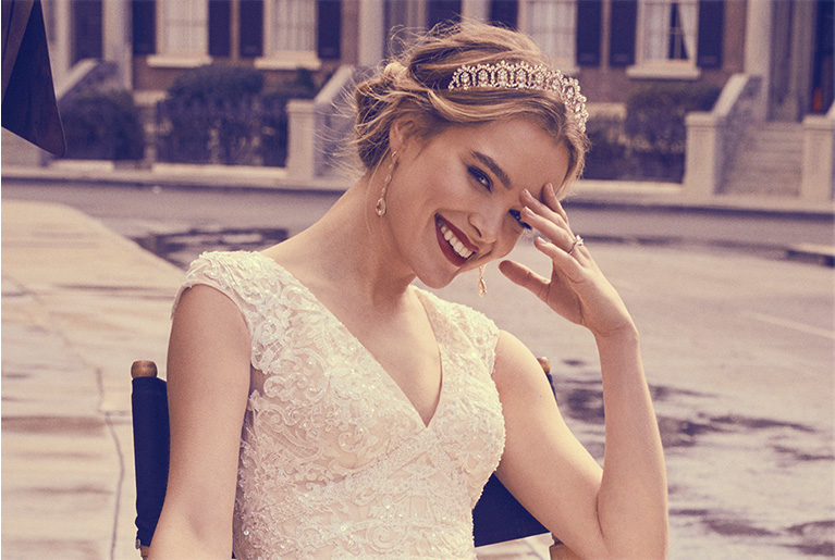 bride hairstyle in a low bun wearing a tiara