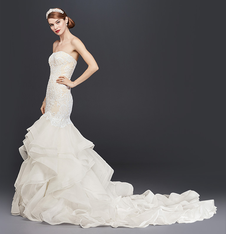 Side shot of mermaid wedding dress with cathedral train