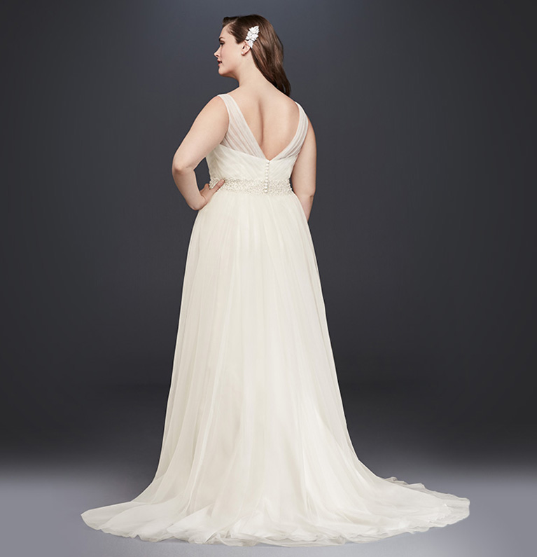 Back Shot Of Plus Size Bridal Gown With Sweep Train