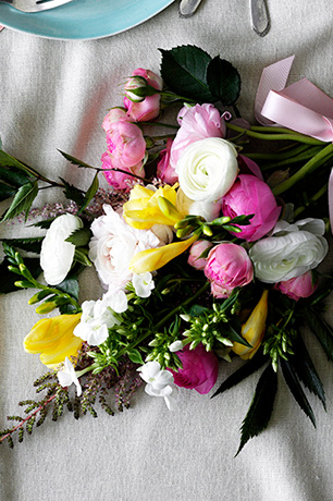 Colorful spring bouquet with ranunculus and peonies