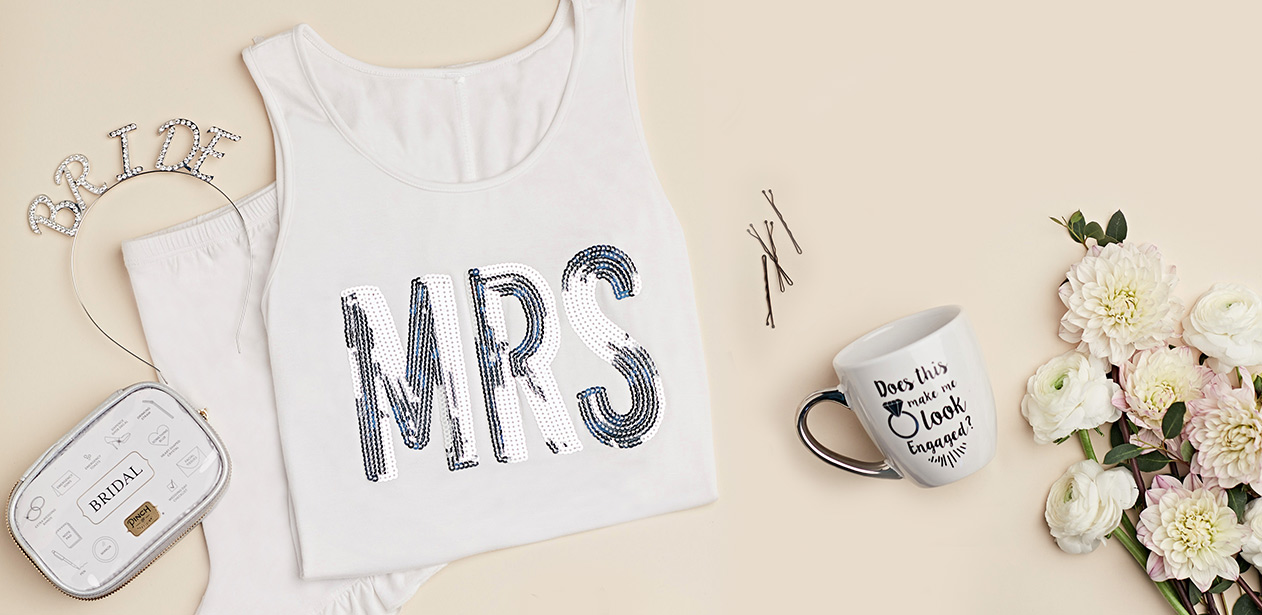 Bridal gifts including jeweled 'Bride' headband, MRS tank top, and 'Does this ring make me look engaged' mug.